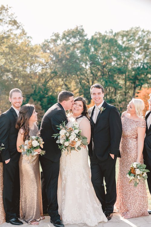Beautiful Fall Wedding, with ivory and gold floral bouquets. Bridal party wearing warm, mismatched rose gold gowns to compliment the fall decor.