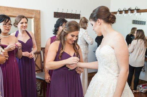 Helping the bride get ready purple bridesmaid dress