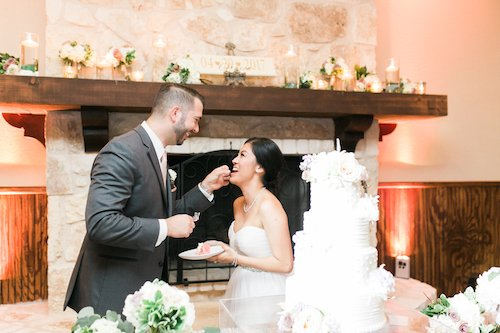 Cake cutting bride and groom wedding cake