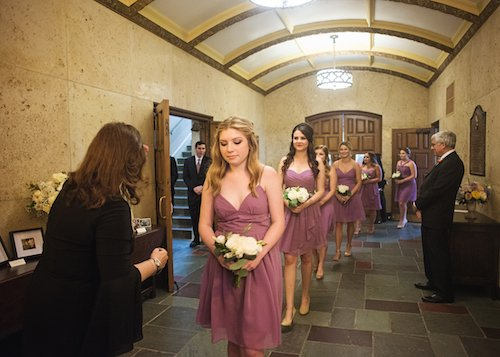 Bridesmaids lined up pre ceremony lavendar dresses