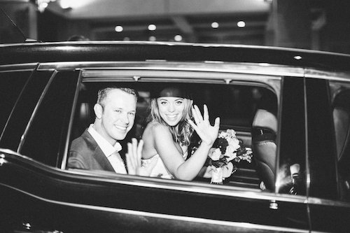 Getaway car bride and groom