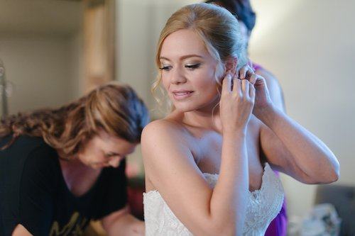 Bride getting ready putting in earring