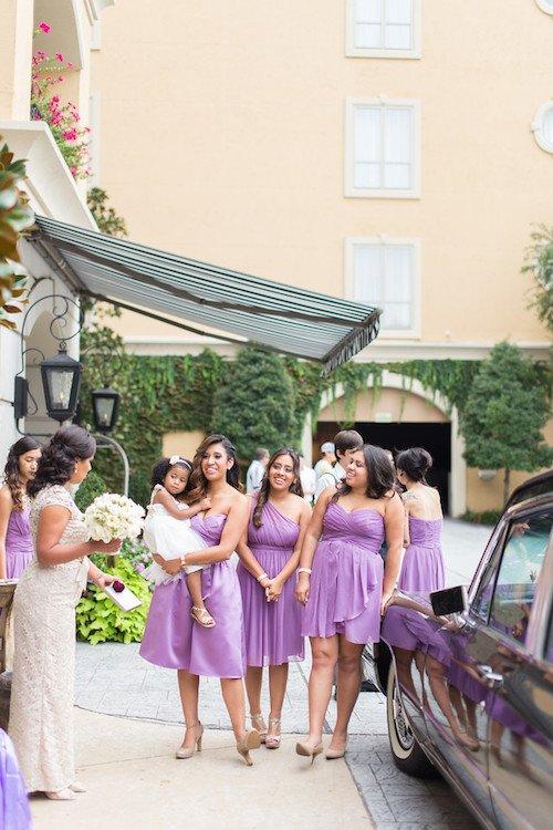 Purple dress bridesmaids outside hotel