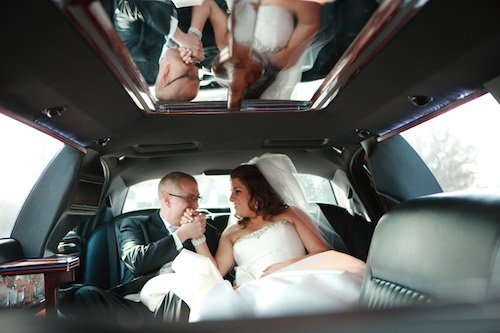 Bride and groom back of limo