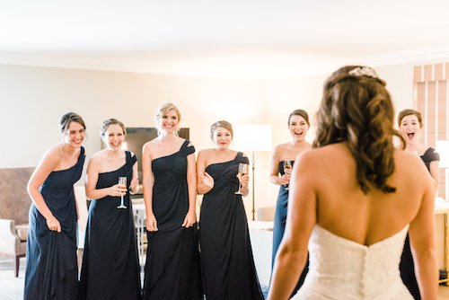 Bridesmaids and bride first look