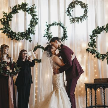 Jillian Zamora Photography - Wedding Ceremony - Greenery Wreath Backdrop - Maroon Wedding Ceremony