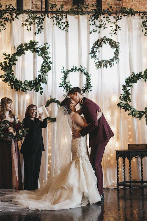 Jillian Zamora Photography - Wedding Ceremony - Greenery Wreath Backdrop - Maroon Wedding Ceremony
