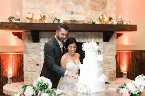 Bride & groom cut the cake - Wedding cake - ivory and green wedding