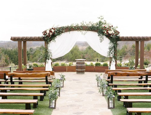 The pergola was stunning, decorated with fresh greenery and beautiful burgundy and crème floral.  The white draping gave it the perfect elegant touch for the ceremony.