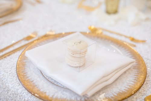 "Guests found their seats by checking out the fantastic mirror gold table numbers and seeing their name in custom acrylic colors (indicating their choice of meal) set at each place setting.  They also received a tasty treat of custom macaroons in the wedding colors and ""J&T"" imprinted on them. - Custom Names - Custom Macarons - Wedding Favor - Gold & White - Wedding Planner - Each & Every Detail"
