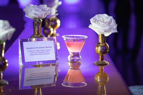 After ceremony, guests were greeted with Taylor's signature cocktail in the all white and gold cocktail space, which included a fun clear acrylic seating chart to let guests know their assigned tables. - Dallas, Texas - Hall on Dragon - Cocktail hour - Wedding Planner - Each & Every Detail