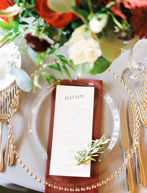 While the ladies and gentlemen dressed (check out the cute floral robes the ladies had), the reception was created. The tables were adorned in simple linens of grey and lush centerpieces of continuous burgundy and cream blooms with lots of loose greenery and candles!