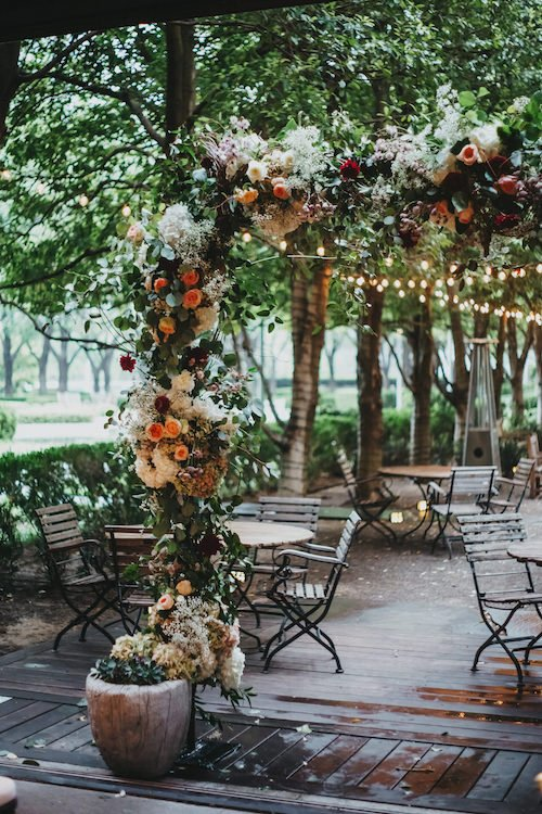 We chose to open those doors and build the floral ceremony arch from Garden Gate Floral Design in the doorway. While we weren't actually outside, those doors being open allowed for the natural ambiance during ceremony. Plus the Garden Gate was a huge factor in making this now indoor wedding, a garden. - Marie Gabrielle - Dallas, Texas - Wedding Planner - Each & Every Detail