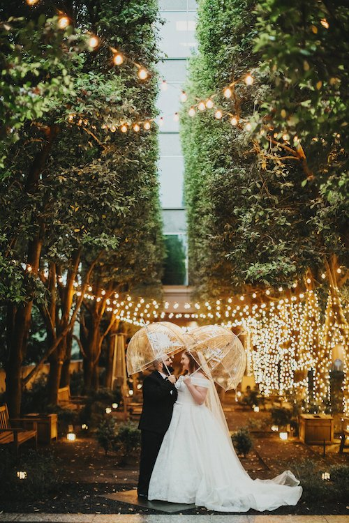 Megan & Mathieu came to us with their garden wedding at the stunning Dallas venue, Marie Gabrielle. While they did have quite a bit of their outdoor wedding already planned out, we had to move nature indoors when Dallas decided to pour down rain the day of the wedding. The earth tone colors with pops of pink and with lush greenery were throughout the décor. The challenge was being able to achieve the feeling of being outside in a garden!  - Dallas, Texas - Wedding Planner - Each & Every Detail
