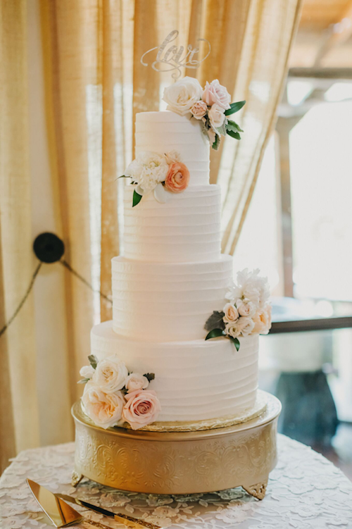 There's something to be said for a classic, elegant, bridal cake. The soft texture and perfectly placed floral pull together the warmth and beauty of this incredible cake. - Wedding Cake - Coral and Ivory Wedding