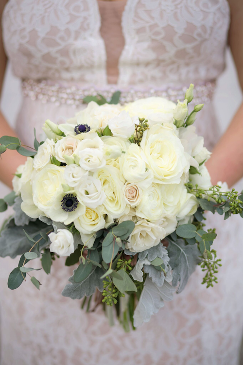 The beautiful elegance of all those roses brings another element to an already stunning bouquet While the loose greenery on the outside frames the classic white flowers, making it stand out from the dress. - Bridal Bouquet - Wedding Planner - Each & Every Detail