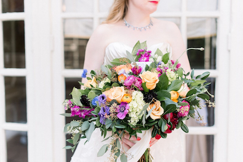 The colors in this sunset inspired bouquet were spectacular. From the pale orange roses to the purple lisanthus and all of the greenery in between, we still can't get over this bold bouquet. - Bridal Bouquet - Dallas Texas - Wedding Planner - Each & Every Detail
