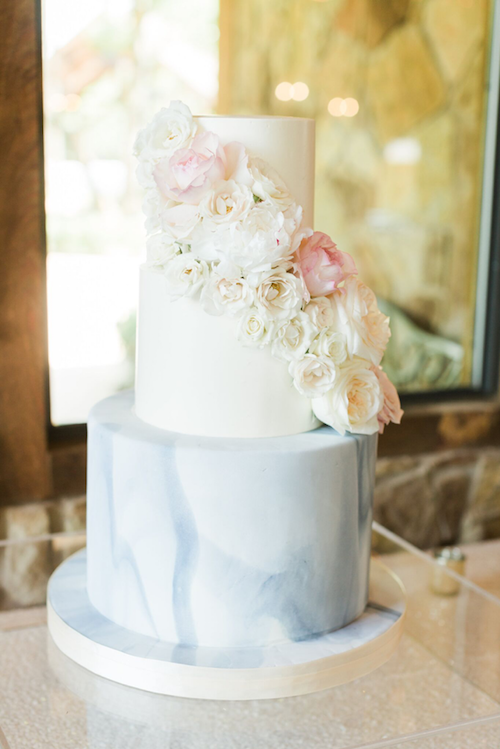 How about this beautiful bridal cake? The clean lines and marbled fondant bring a modern aesthetic to the rustic venue making the whole thing feel light and airy.
