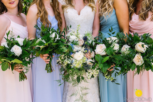 All we can say about these lush bouquets is wow! All of that greenery is the perfect complement to the colorful bridesmaids' dresses. - Dallas Texas - Bridal Bouquet - Wedding Planner - Each & Every Detail