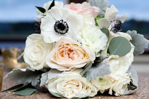 This bouquet looks so soft and romantic! The centers of the anemones bring some pop to the beautiful the roses and the dusty miller ties it all together for some added texture and color. - Dallas Texas - Bridal Bouquet - Wedding Planner - Each & Every Detail