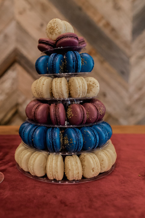 We love using macarons to incorporate the colors of a wedding. In this case the rich blues and reds from the floral and stationery make another appearance in this macaron tower. What a great dessert option!