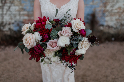 Check out this rich bouquet! The little succulents hidden amongst the bold burgundy peonies have our hearts. - Dallas Texas - Bridal Bouquet - Wedding Planner - Each & Every Detail