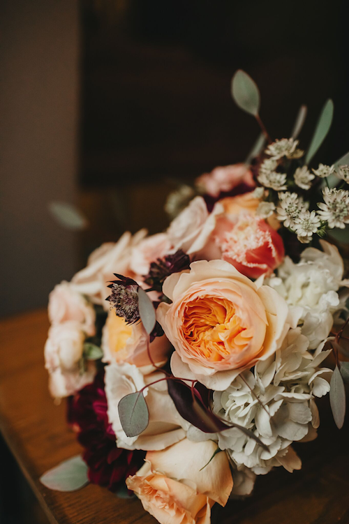 We love the warmth of this bouquet! The mix of the peach Juliette roses, burgundy dahlias, and touch of eucalyptus has wanting more. - McKinney Texas - Bridal Bouquet - Wedding Planner - Each & Every Detail