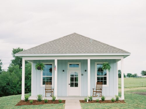 Of course, we have to start with the super cute cottages for the couple to get ready in!  The all white cottage is perfection for brides and the sweet light blue cottage is perfect for her groom.  And who can resist an outdoor swing on a covered porch? - The Grand Ivory - McKinney, Texas - Wedding Planner - Each & Every Detail