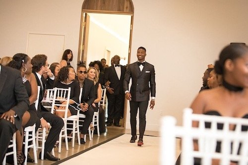 This is a well-rounded look! While it's a beautiful classic black suit, look closer to see the spiked shoes with red soles. The little touches just make this outfit extra. - Groom's Attire - Groom Look - Dallas Texas - Dallas Wedding Planner