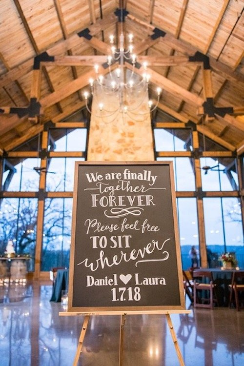 The Lodge is a unique stone and wood venue that really sustains its beauty with all different décor styles. Laura and Dan definitely played in to the rustic side of The Lodge with their horseshoes, wood slices, and wine barrel cake table. That didn't stop them from showing their elegance with their sleek black linens and their sharp attire. - Rustic Wedding Reception - Red Rose Centerpieces - Lodge Wedding - McKinney Wedding Planner - Each & Every Detail