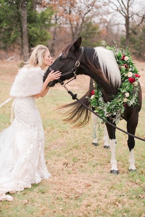 We cannot forget about Bow, one of Laura and Dan's most special guests – Laura's Horse! While she had a dream of riding into the ceremony horseback, the venue couldn't allow it due to his weight and not wanting to break their beautiful stone pathway. Laura still couldn't have Bow not be a part of the day and after talking through all our options, he made an appearance pre-ceremony for a little photoshoot. - Wedding Horse - Horse with Flower Garland - Bride and Horse - Denton Texas - McKinney Wedding Planner - Each & Every Detail