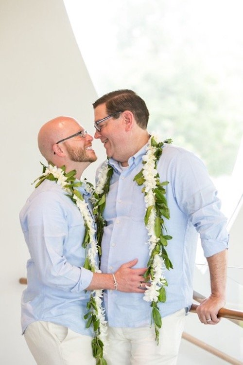 We invited guests to be seated to enjoy the hula performance on stage. While our dancers distracted the guests, Chad and Rich slipped downstairs to change into their ceremony outfits. As the hula dancers completed their show, the couple processed down the aisle with the officiant. Surprise! It's a wedding! - LGBTQ Wedding - Dallas Texas - Dallas Wedding - Wedding Planner - Each & Every Detail
