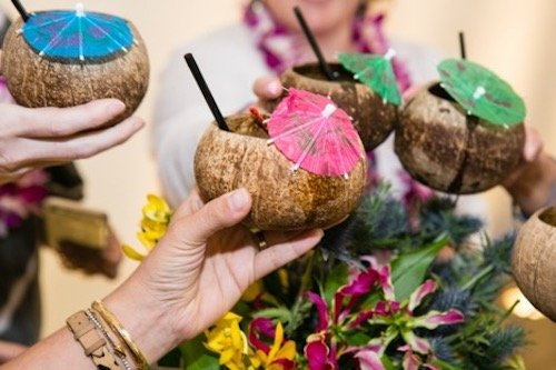 As guests arrived, they were greeted by hula dancers and supplied with leis. A polaroid camera and a guest book gave guests the opportunity to take photos as if just arriving in Hawaii after a long flight. Inside, we included fun palm patterned linens, bright island blossoms, tropical beverages served in coconut cups, and a buffet spread that included a whole roasted pig! Our cake was a bit of a double blind – the topper declared 'Finally!', referencing not only Chad's long journey through nursing school, but also the couple's steadfast relationship and commitment to one another. - LGBTQ Wedding - Surprise Wedding - Dallas Wedding - Dallas Texas - Wedding Planner - Each & Every Detail