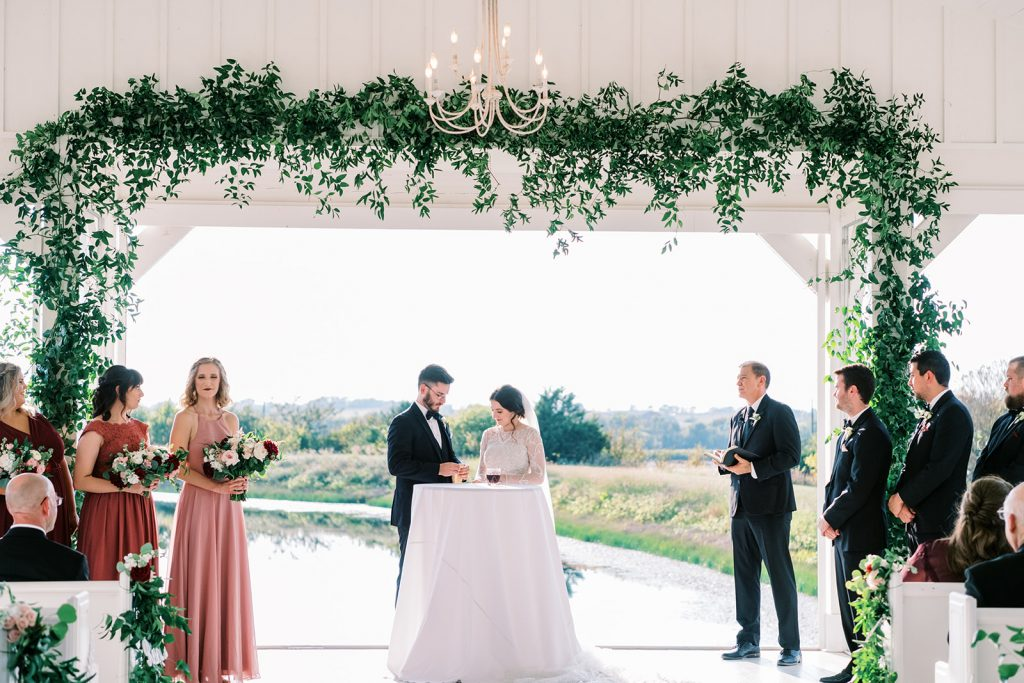 McKinney, Texas - Texas Outdoor Wedding - Each & Every Detail - Mauve & Burgundy Wedding - Lush Greenery Wedding - Unity Candle Ceremony - Open Air Chapel - The Grand Ivory
