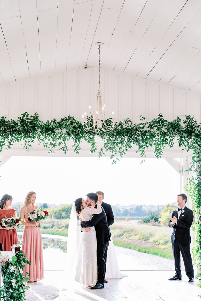 McKinney, Texas - Texas Outdoor Wedding - Each & Every Detail - Mauve & Burgundy Wedding - Lush Greenery Wedding - Kiss the bride - Open Air chapel - The Grand ivory