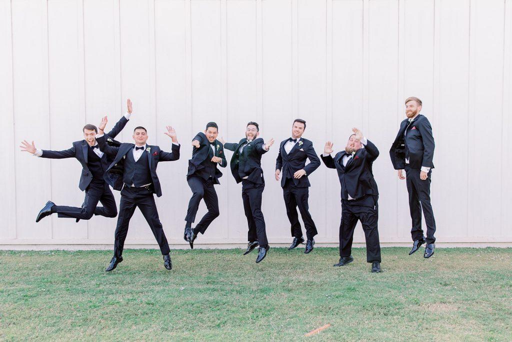 McKinney, Texas - Texas Outdoor Wedding - Each & Every Detail - Mauve & Burgundy Wedding - Lush Greenery Wedding - Fun Groomsmen Picture - Jumping Groomsmen Photo