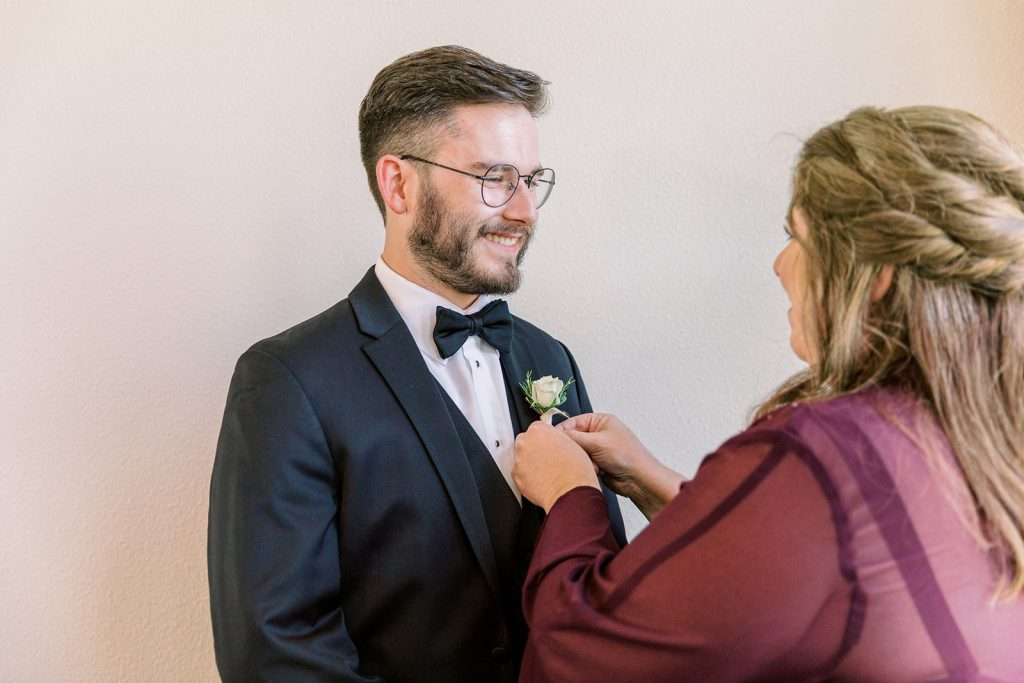 McKinney, Texas - Texas Outdoor Wedding - Each & Every Detail - Mauve & Burgundy Wedding - Lush Greenery Wedding - Mother of the Groom - Pinning the Boutonniere