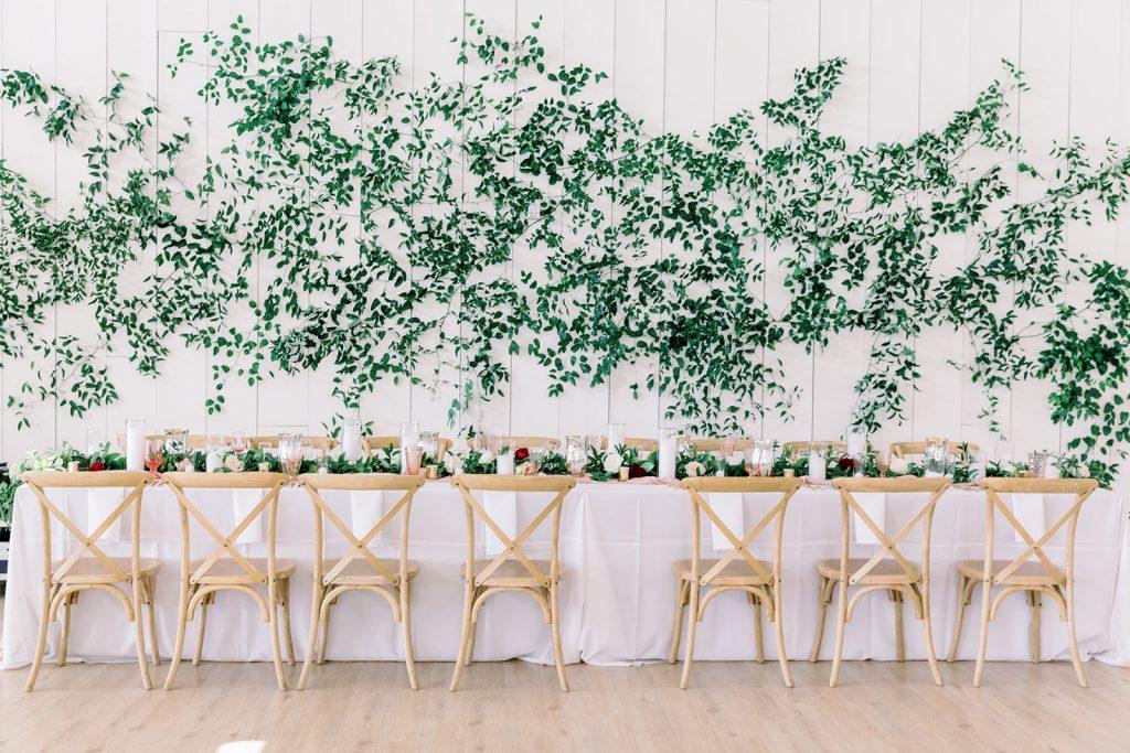 McKinney, Texas - Texas Outdoor Wedding - Each & Every Detail - Mauve & Burgundy Wedding - Lush Greenery Wedding - HEad Table - Greenery Wall -