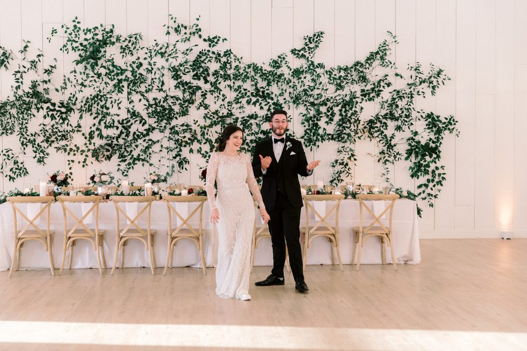 McKinney, Texas - Texas Outdoor Wedding - Each & Every Detail - Mauve & Burgundy Wedding - Lush Greenery Wedding - First Look at Reception - Greenery Wall - Surprise Wedding Reveal